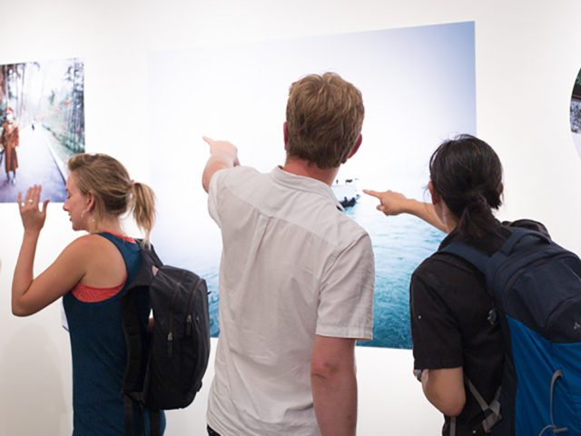 Audience pointing at artworks in Aquatopia exhibition 2018