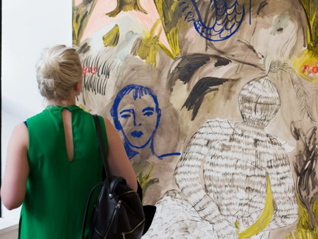 Photograph of woman looking at Faye Wei Wei painting at CFCCA