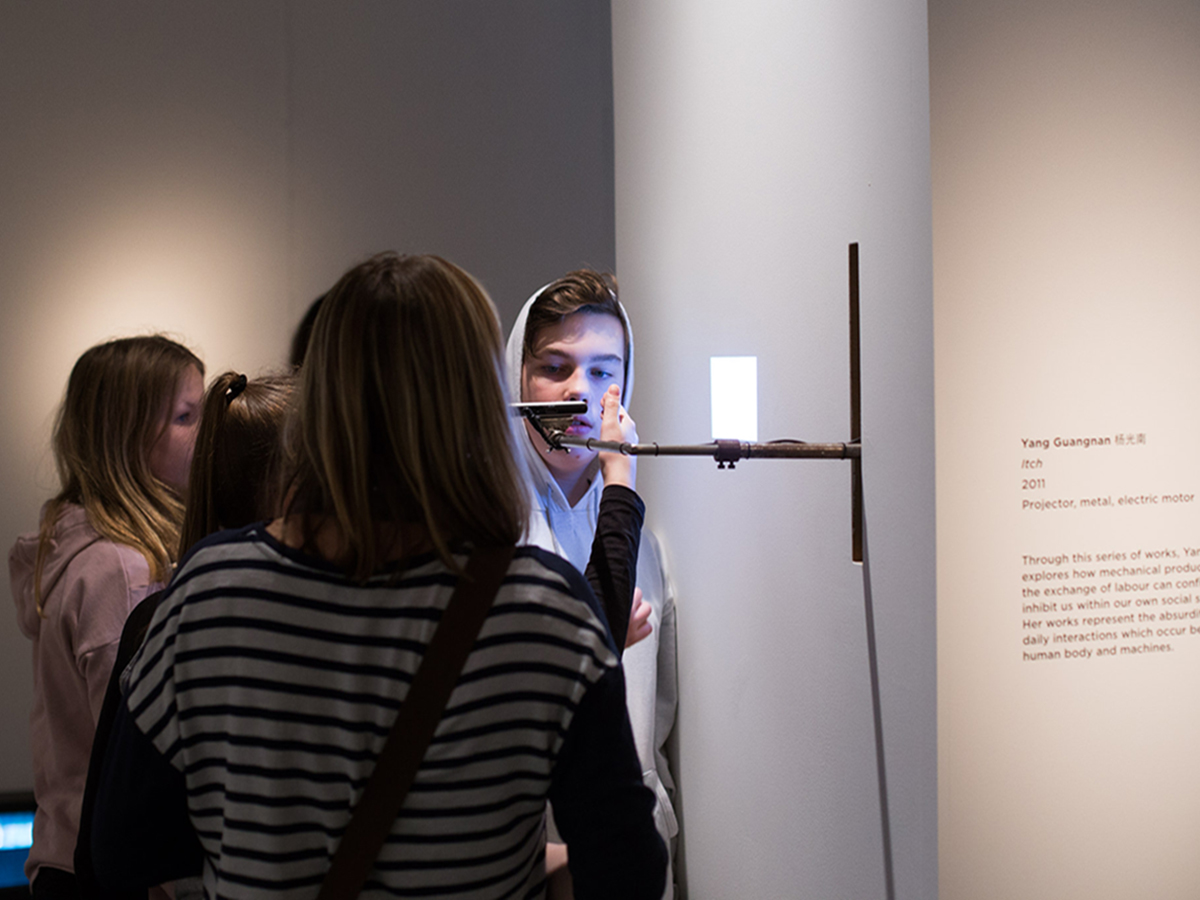 Photography of young people looking at Yang Guangnan's artwork as part of NOW exhibition at CFCCA